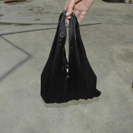 Gundara - Black Burqa Handbag by Zardozi - made by Afghan refugees
