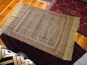 Baluch rug on the floor